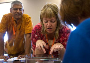 Santosh Zachariah (left) from the Evergreen School in Shoreline, Washington, and Maggie Huddleston from Sand Ridge Junior High School in Roy, Utah, examine cooking spices using the iPad microscope they constructed Monday, June 6. The NSCF Scholars built their own iPad microscope stands to bring back to their schools. (Photo by Sam Oldenburg)