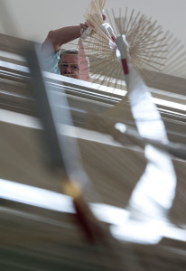 Bruce Boehne from Zion Lutheran School in Dallas, Texas, sends a wave down the wave machine constructed by the NSCF Scholars Wednesday, June 8. (Photo by Sam Oldenburg)
