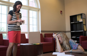 Jill Henry (left) from Herrick Middle School in Downers Grove, Illinois, and Melissa Harris from Warren East Middle in Bowling Green create a hypothesis cube Monday, June 6. (Photo by Tucker Allen Covey)