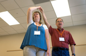 Maggie Huddleston (left) of Roy, Utah, and SKyTeach Master Instructor Rico Tyler demonstrate through dance how the moon orbits around Earth Wednesday, June 8. (Photo by Tucker Covey)